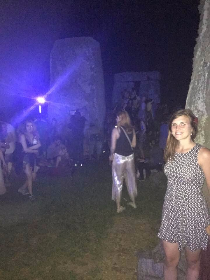Touching the stone at the Summer Solstice!